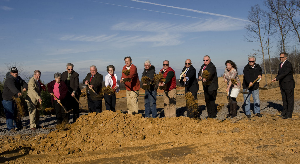 Town and county officials participate in the ground breaking ceremony of the Leach Run Parkway off Oden Street Wednesday afternoon in Front Royal. Rich Cooley/Daily